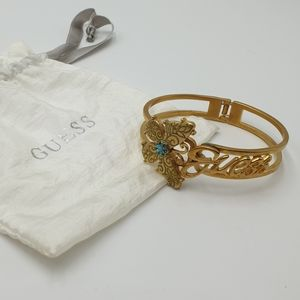 Guess Brass Tone Butterfly Logo Hinge Open Braclet Blue Crystal Embellishment